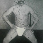 Fujita Seiko while practicing Yoga, with 500 big tatami needles stuck through parts of his whole body.