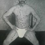Fujita Seiko while practicing Yoga, with 500 big tatami needles stuck through parts of his whole body.