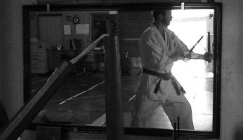 The author A. Quast practicing inside Nagamine dojo in Naha Kumoji, February 2008.