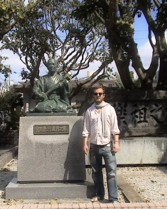 The author at the Monument of the Afuso-ryū of classical Ryukyuan music close to the Okinawa Prefectural Library in Naha.