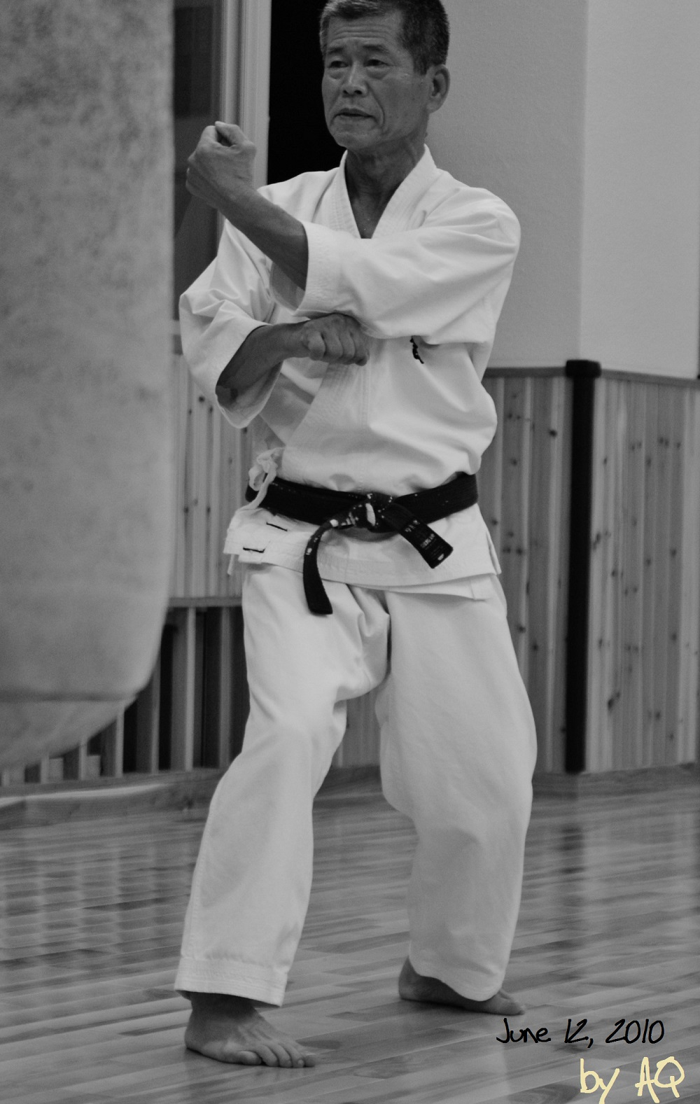 Photo of Miyahira Sensei, a carpenter certified to restore listed buildings like castle etc. performing Naihanchi, June 12, 2010, Shinbukan Dojo, Tomigusuku. Photo: A. Quast.