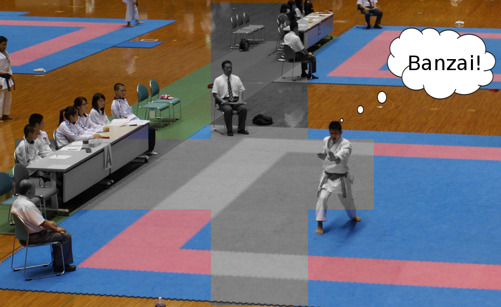 Ryo performing his standards as the judges and officials watch on.
