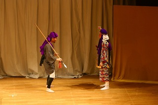 "The Kumi-odori called ""Motobu Ufunushi"": Ganachiku and his eibō, pointing downwards."