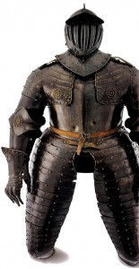 Three-quarter harness. Date around 1630. Origin Germany. Material iron, leather. Height: 185 cm, width 66 cm. Weight: 24.5 kg. At the beginning of the 17th century the heavy cavalry wore this kind of armor reaching to the knee, boots protected the lower leg. The lance had often been abandoned in favor of a sword and a pair of pistols carried in holsters on the saddle. Officers also preferred that armor in field combat.