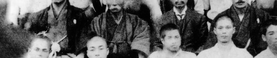 """In its July 2006 issue, """"Monthly Karatedō"""" magazine (now discontinued) reported about a """"major historic discovery"""". This refers to the above photograph. In its center can be seen a man with a mustache. This man was considered to be Itosu Ankō. At that time, the Okinawa Times also took up the news, but the man with the mustache was now identified as being a different person, namely Miyake Sango."""